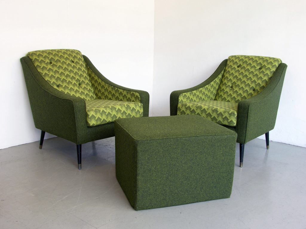 green colored fabric upholstery armchair