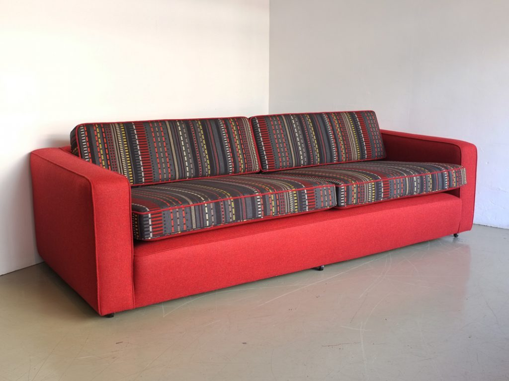 red colored upholstery couch