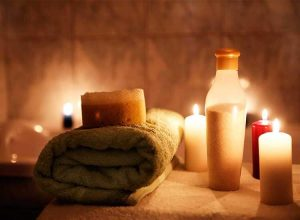 Beautiful spa image with burning candles and mssage towel - spa massages center