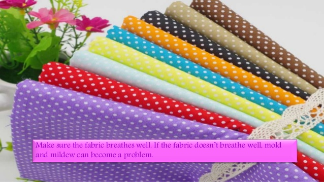 A bunch of colored and designed fabrics for upholstery