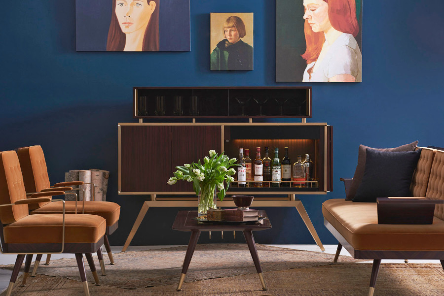 An upholstery image set showing a sofa, table, bar counter and beautiful sketches hanging on the wall.
